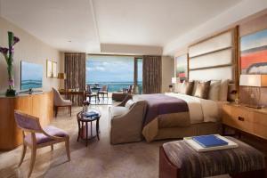 Mulia_The Baron Suite - Bedroom (purple) ––girlwilltravel.com