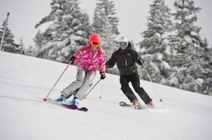 Skiers take to the slopes at Stowe Mountain Resort.